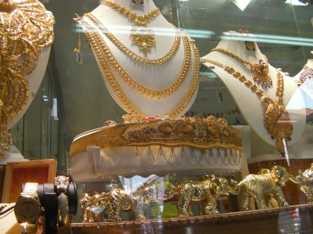 gold necklaces and elephant statues