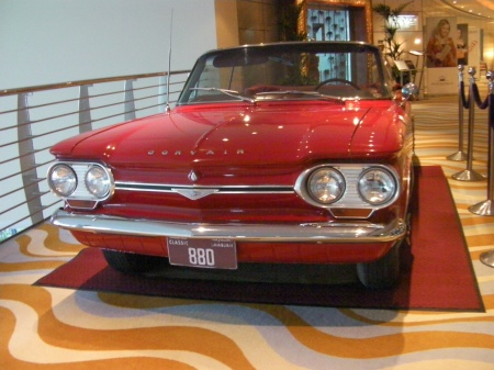 red classic Corvair car head on