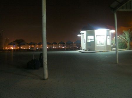 night time, parking lot and kiosk