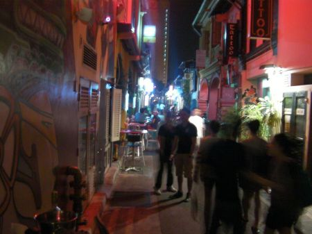 busy pedestrianized alley with lots of shops and restaurants