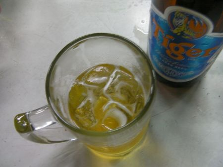 mug of beer with ice in it
