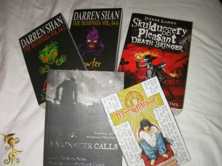 Two Demonata series books by Darren Shan, Skulduggery Pleasant: Death Bringer by Derek Landy, Death Note vol. 2, A Monster Calls by Patrick Ness