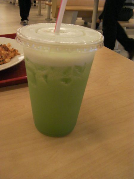 cup of bright green juice