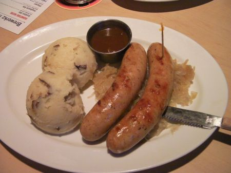 mash potatoes, two sausages, sauerkraut