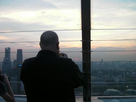 man taking a picture of the sunset