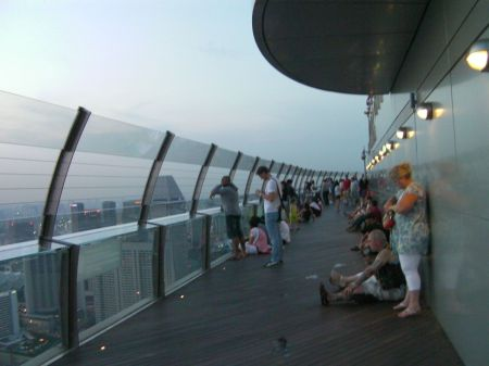 tourists sitting on the observation deck