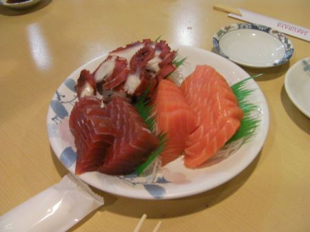 plate of salmon, tuna, and octopus sashimi