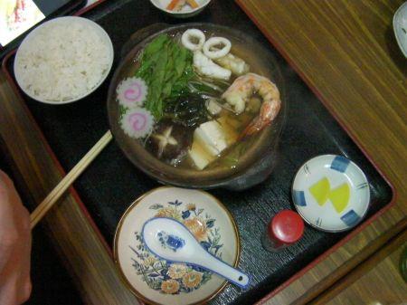soup containing mushroom, shrimp, oyster, calamari, tofu, and more