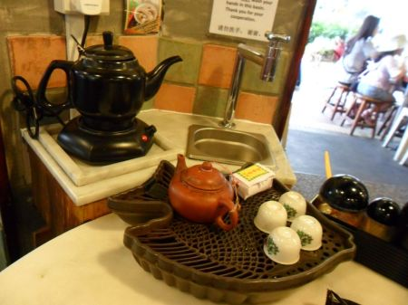 tea kettle, sink, tea pot and tiny cups