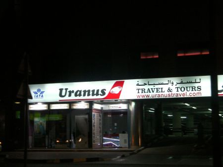 Uranus travel and tours business sign