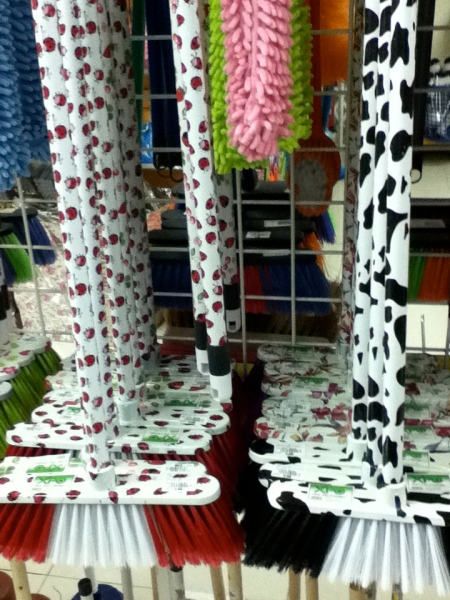 brooms covered in ladybug design or black and white spotted cow design