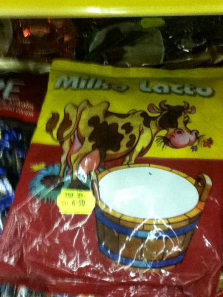 candy package with a cow and a large pail of milk pictured on it titled milko lacto