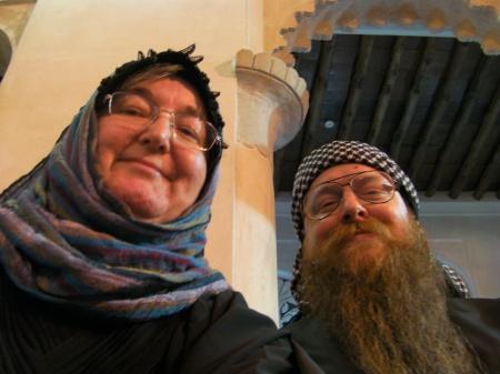 man and woman dressed in Emirati fashion