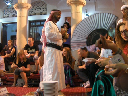 bedouin man serving coffee