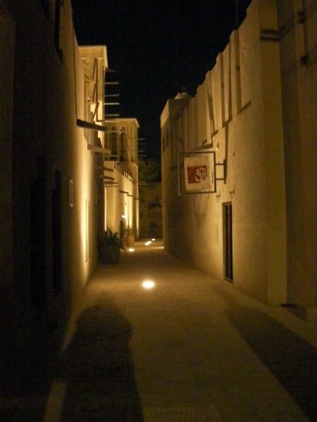 traditional buildings lit at night