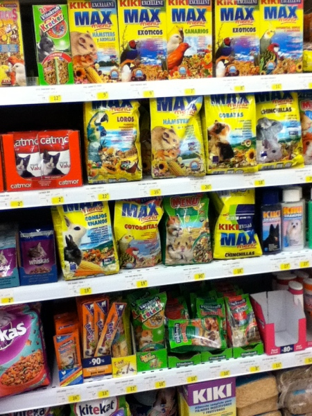 grocery shelves containing pet treats