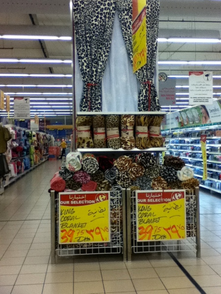 store display of animal print fleece blankets