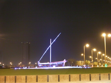 boat sculpture lit in blue lights