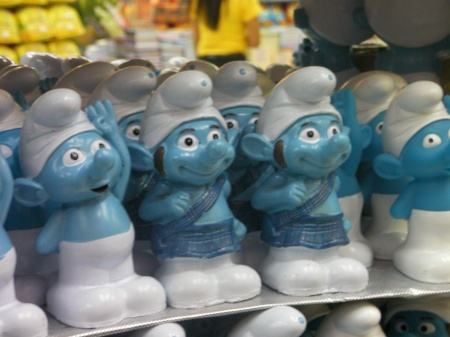ceramic smurfs with sideburns and wearing kilts