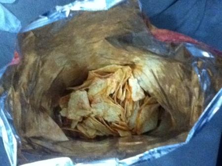 interior of potato chip bag less than half full