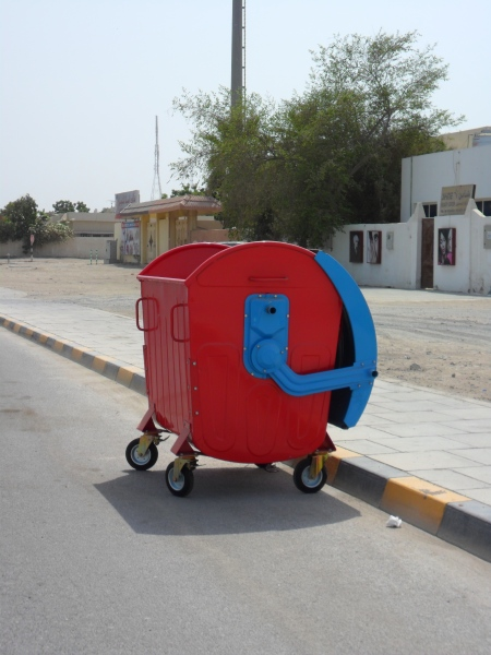 red and blue dumpster