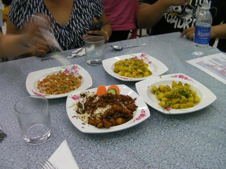 four dishes of food