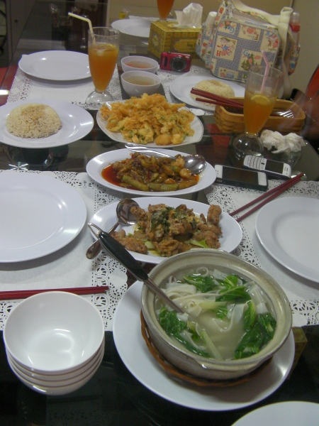 table full of dishes and food
