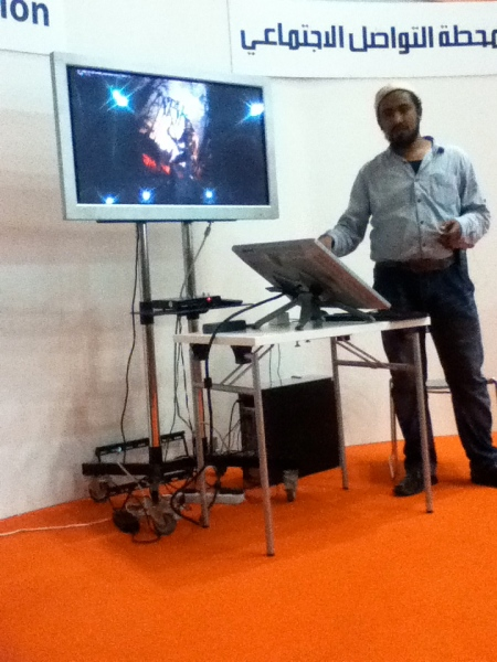 man demonstrating computer graphic art