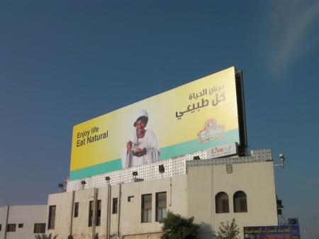 billboard advertising Taza restaurant, enjoy life, eat natural