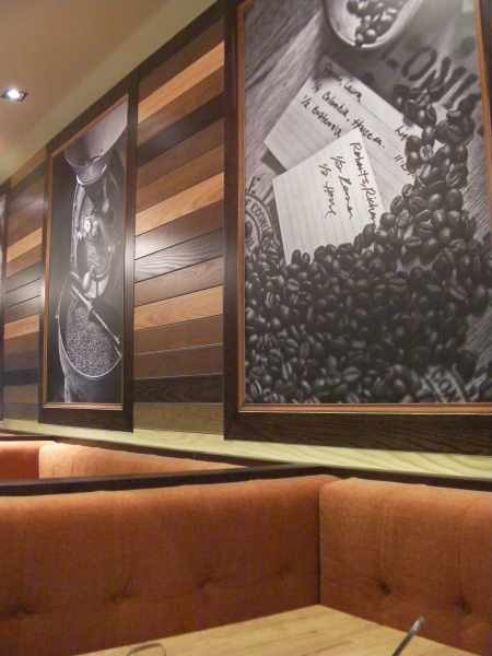 orange upholstered booths and frame coffee pictures