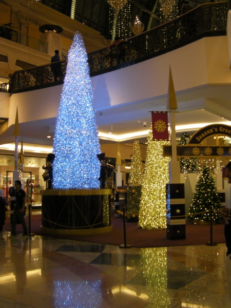 Christmas trees in the mall covered in lights