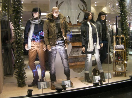 store window with manikins dressed in winter clothes