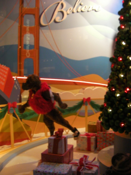 animatronic display of figures skating around a Christmas tree