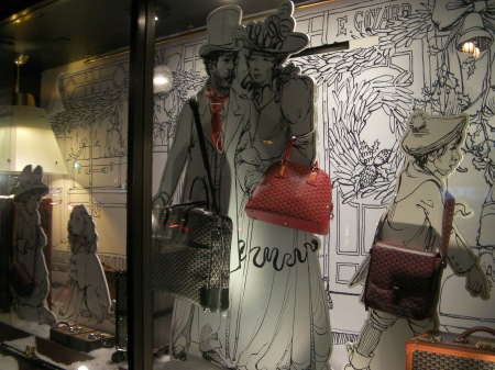 window display of Victorian people with handbags