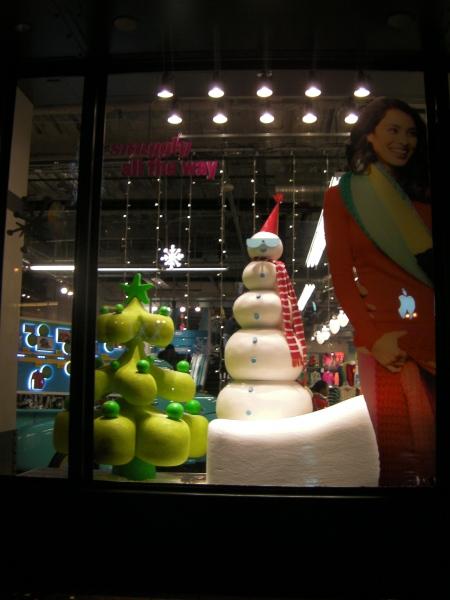 snow man and Christmas tree window display