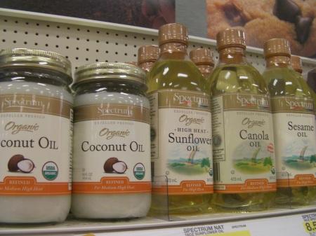 coconut oil, safflower oil, canola oil, sesame oil on store shelf