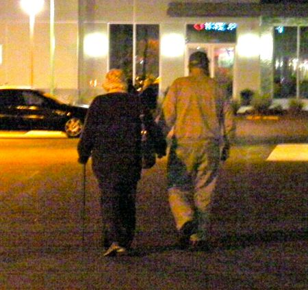 couple walking away holding hands