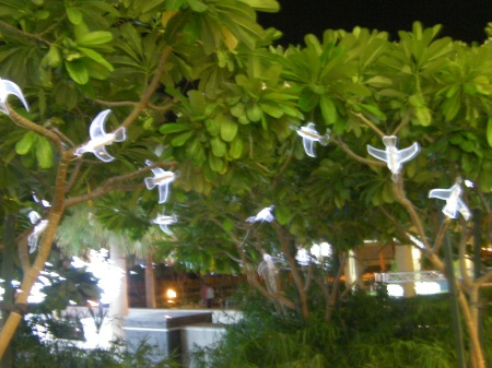 light decorations of birds in the trees