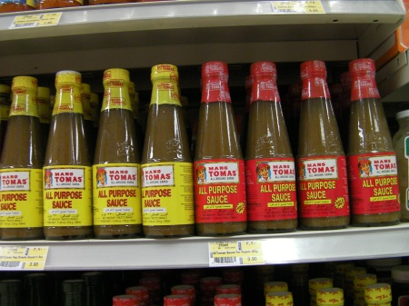 bottles of all purpose sauce on the store shelf