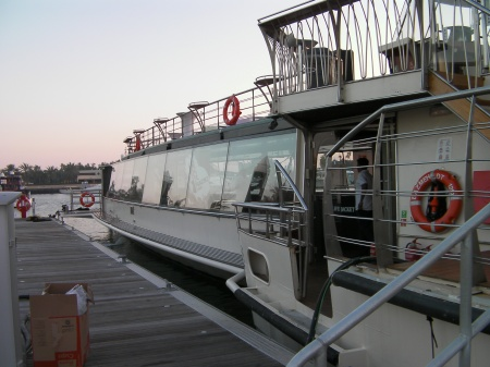 long boat with glassed in lower level and open deck on top