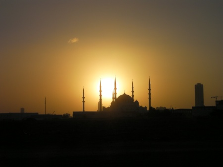 mosque with sun directly behind it