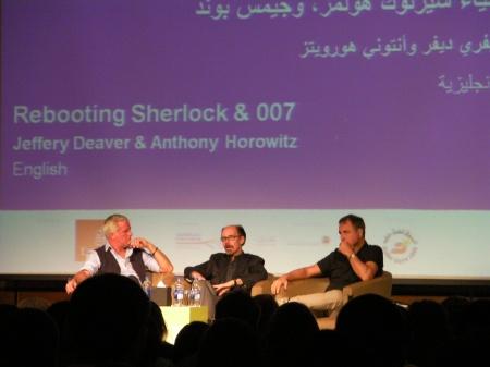 three men on a stage