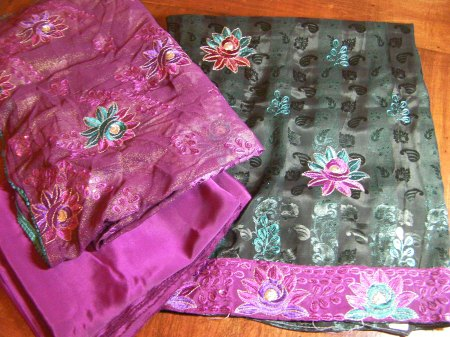 black fabric with teal and pink flower embroidery, pink fabric with flower embroidery, plain pink fabric