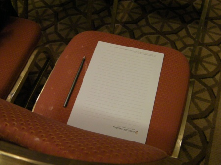 chair with a paper tablet and pencil on it