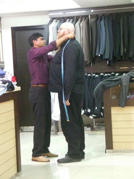 tailor measuring man for a suit