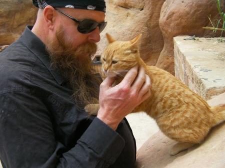 bearded man petting cat
