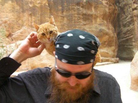 cat on man's shoulders