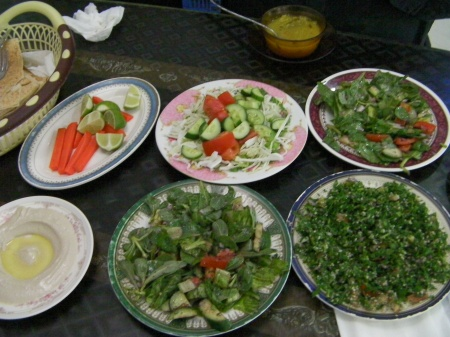four plates of salad