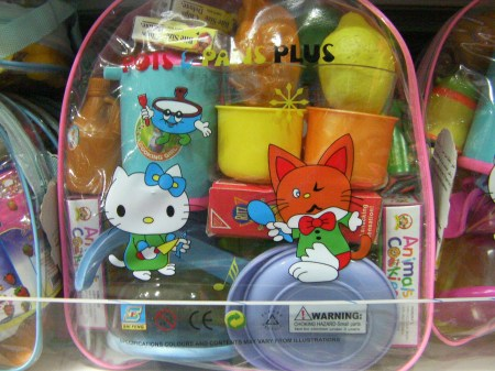 toy kitchen set with Hello Kitty and another cartoon cat on the package