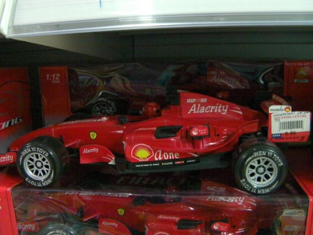 "toy race car labeled ""alacrity"""